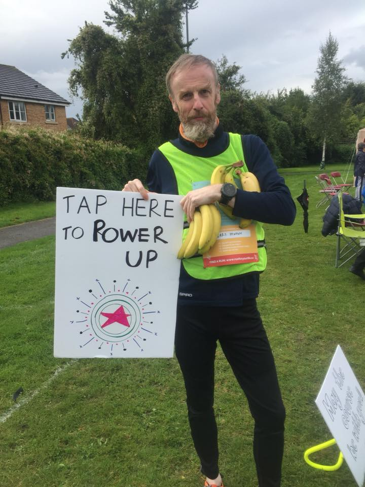 Richard holding up a sign